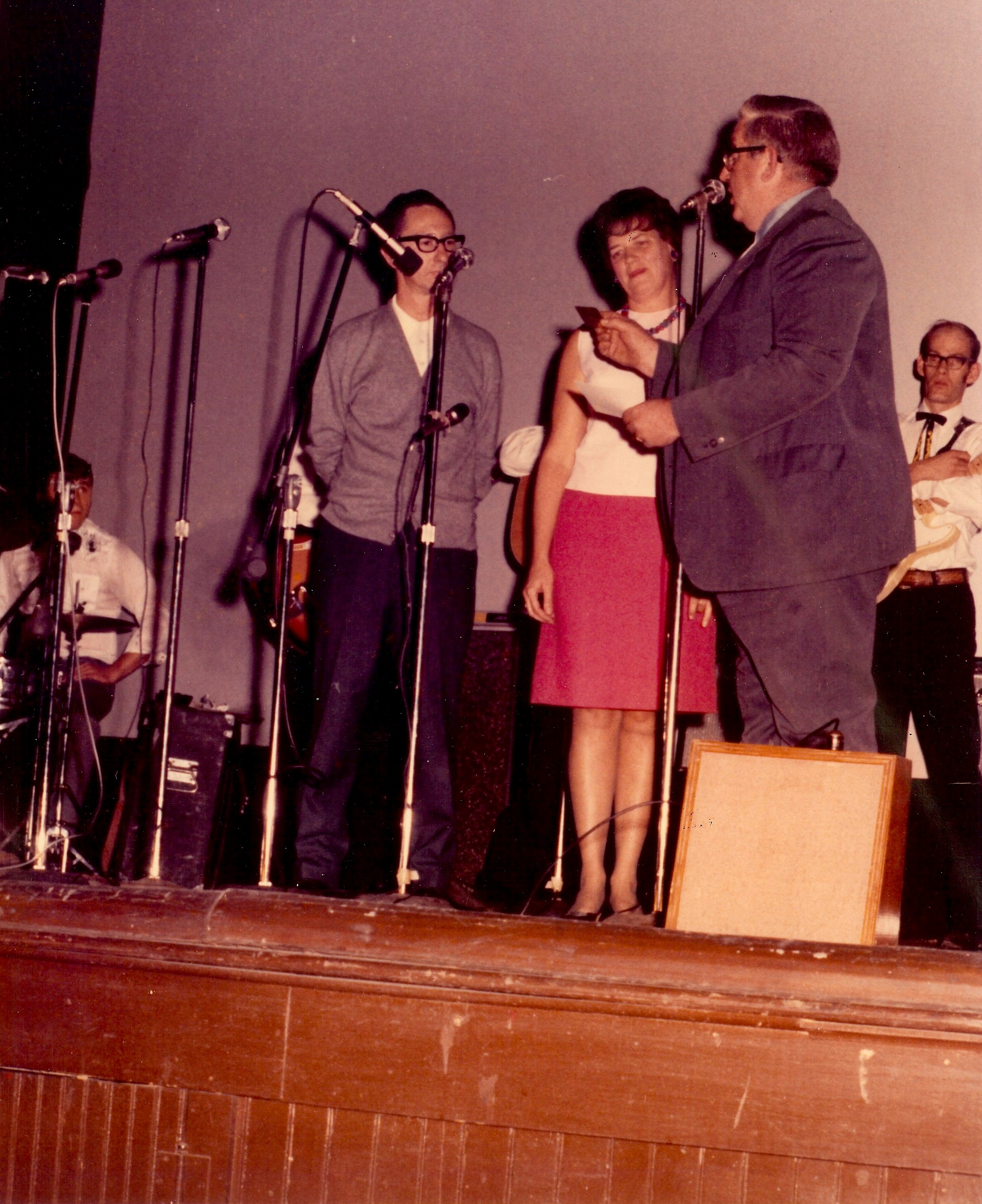 Onstage at the Keystone Theatre, the Buffington's receive an appreciation award from a representative of the Penn York Country Music Club, circa 1970