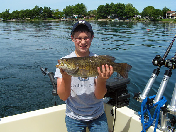 Henderson Harbor Fishing with Milky Way Charters - Dalton Showing Off His Lunker Bass!