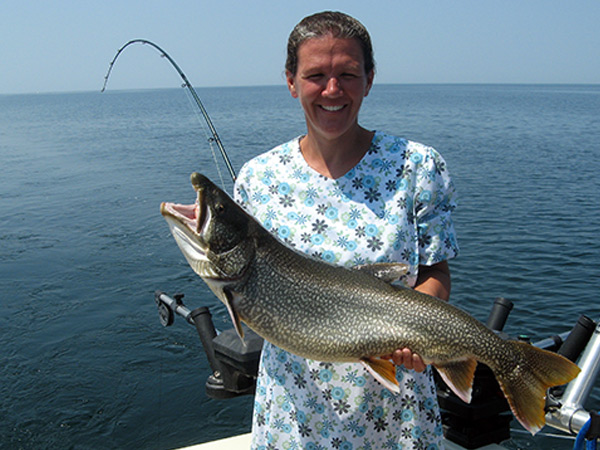 Henderson Harbor Fishing with Milky Way Charters - Dawn Holding A Nice Lake Trout!