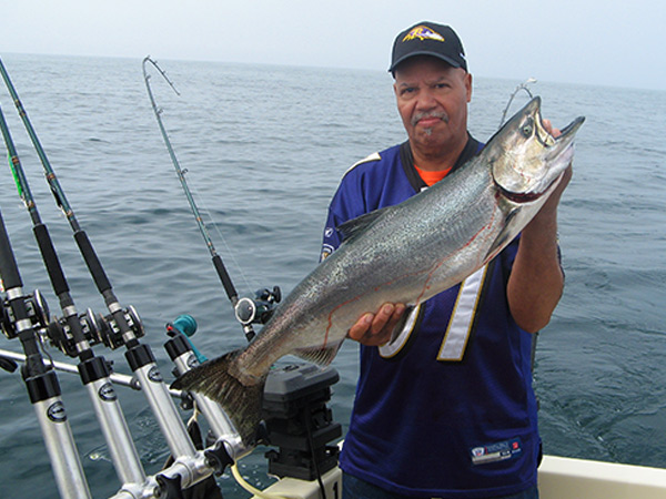 Henderson Harbor Fishing with Milky Way Charters - Greg Holding Beautiful July Salmon!