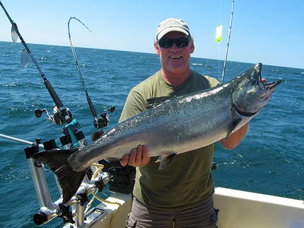 Henderson Harbor Fishing with Milky Way Charters - Matt Clark Displaying Nice Summer King!