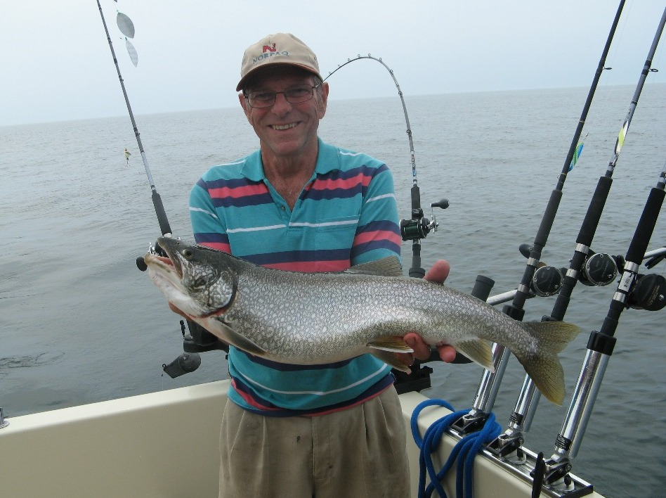 Henderson Harbor Fishing with Milky Way Charters - Bob Zehr holding beauty Laker!