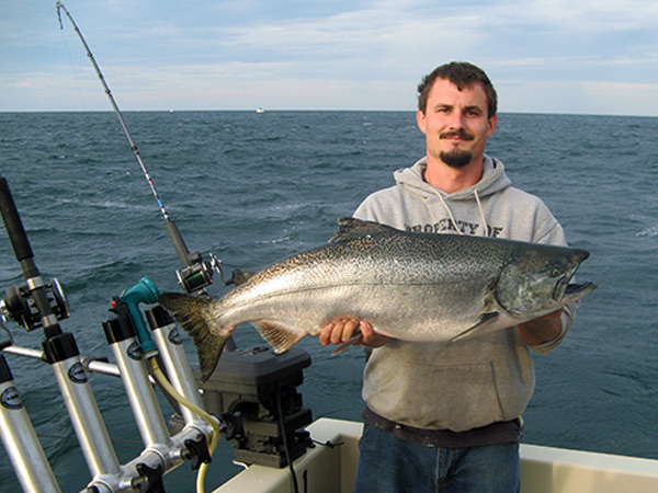 Henderson Harbor Fishing with Milky Way Charters - Brent Showing Off His King Salmon!