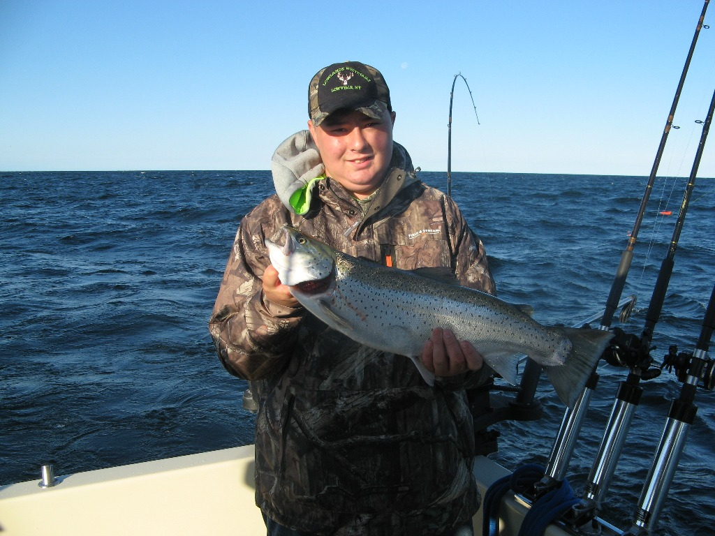 Henderson Harbor Fishing with Milky Way Charters - Tim Rooker Jr. with a nice brown trout!