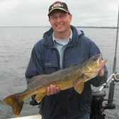 Henderson Harbor Fishing with Milky Way Charters - Luke with a trophy Walleye