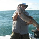 John Displaying His 19 Pounder Trout!