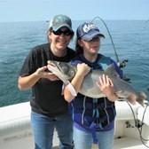 Rachel & Mikayla Holding a 18 Pound Laker!