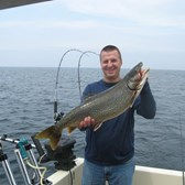 Henderson Harbor Fishing with Milky Way Charters - Nate Olmstead with a nice Laker