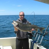 Henderson Harbor Fishing with Milky Way Charters - Randy with a beauty Laker!