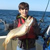 Henderson Harbor Fishing with Milky Way Charters - Simon Displaying His Laker!