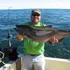 Henderson Harbor Fishing with Milky Way Charters - Larry with Big King!