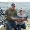 Henderson Harbor Fishing with Milky Way Charters - Neil and Son Derek, Showing Off His King!