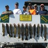 Henderson Harbor Fishing with Milky Way Charters - Ben Pate party with Walleye catch on the board